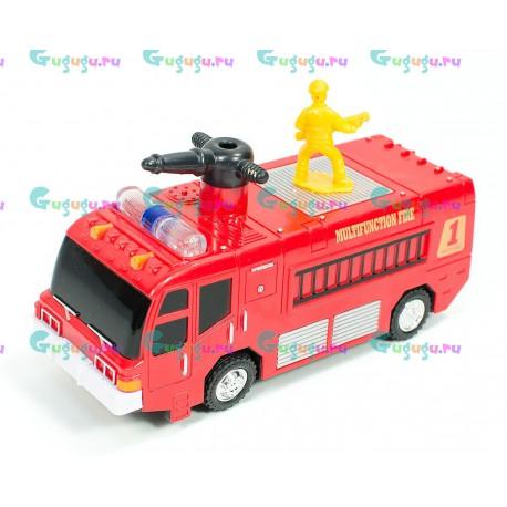 Машина пожарная с пожарником, выпускает мыльные пузыри, едет, отталкивается от препятствий (светит фарами, раздается звук)